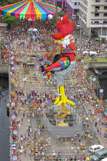 The parade Block Galo da madrugada in Recife Adult Carnival Crowds And Details Carnival Celebration Chinese New Year Crowd Cultures Day Large Group Of People Multi Colored Outdoors Parade People Carnival Crowds And Details Go Higher