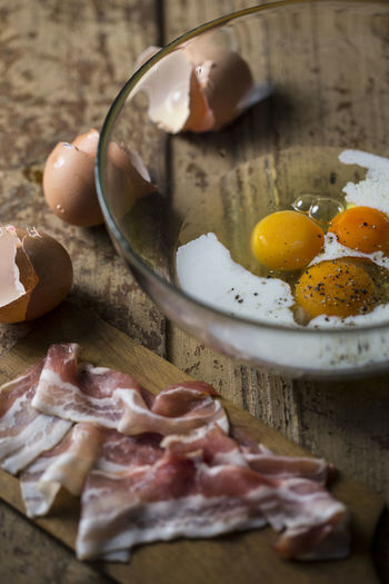 High angle view of meat and eggs on table