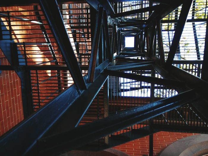 Directly below shot of fire escape by building