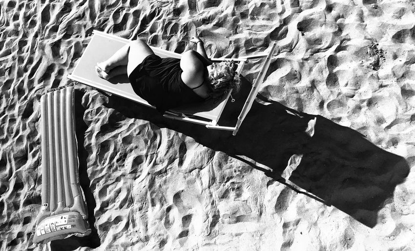 High angle view of woman lying on floor