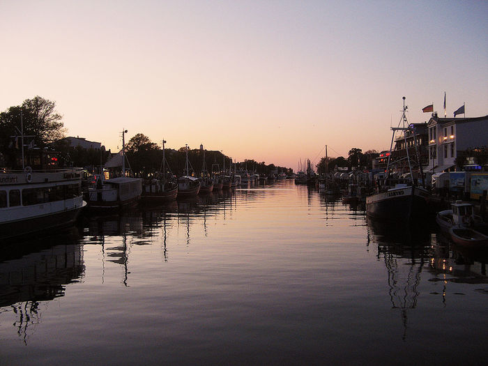 Architecture Boat Building Exterior Built Structure Canal Clear Sky Copy Space Dock Dusk Harbor Mode Of Transport Nautical Vessel No People Old River River To Baltic Oce Reflection River Scenics Sky Sunset Town Tranquility Transportation Warnemünde Water Waterfront