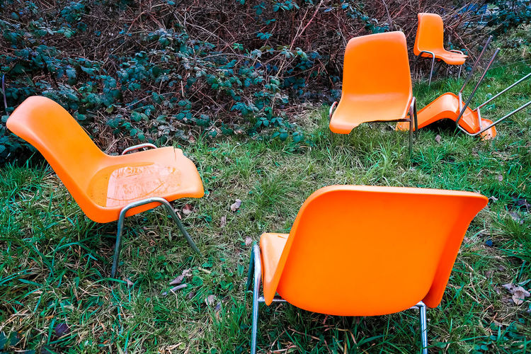 Orange Chairs Art Is Everywhere Beauty In Nature Chair Grass Lost And Found Orange Orange Color Outdoors Plastic Reflection Simplicity Trash Waste X-E2