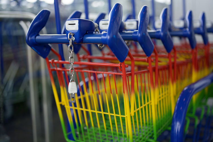 Close-up of colorful shopping cart
