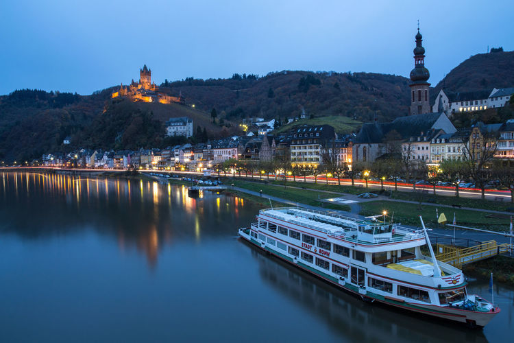 The Reichsburg in Cochem lightens up the darkest nights :) Illuminated City Reflection Bridge - Man Made Structure Water River Architecture Built Structure Travel Destinations Sky Nautical Vessel Outdoors No People Travel Cochem Landscape Ship Boat Cloud - Sky Germany Deutschland Long Exposure