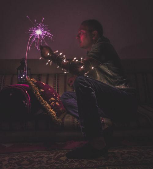 Man playing at night