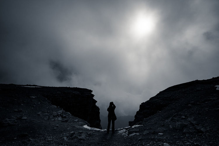 Cloud Adventure Back Lit Beauty In Nature Danger Exploration Fog Geology Hiking Italy Mountain Nature One Person Outdoors Real People Rock - Object Scenics Shadow Silhouette Standing Sunshine EyeEmNewHere Perspectives On Nature Go Higher