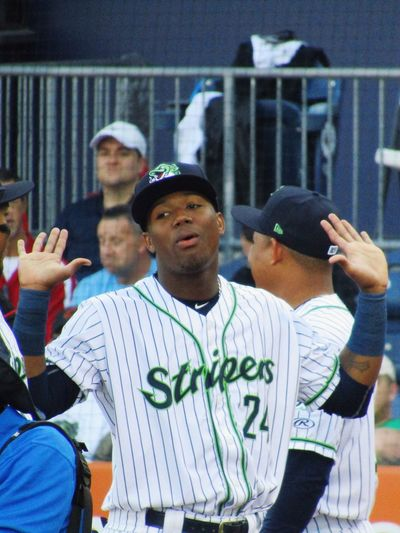 Ronald Acuña Jr in Gwinnett Stripers uniform for 2018 home opener Uniform Hands Up Milb Stripers Gwinnett Ronald Acuna Prospect Baseball Sports Real People Leisure Activity Lifestyles Waist Up Photographing