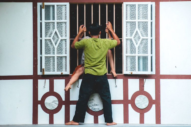 Architecture Couple - Relationship Curtain Day Full Length Indoors  Lifestyles People Real People Standing The Photojournalist - 2017 EyeEm Awards The Street Photographer - 2017 EyeEm Awards Window Window Frame Young Adult Live For The Story