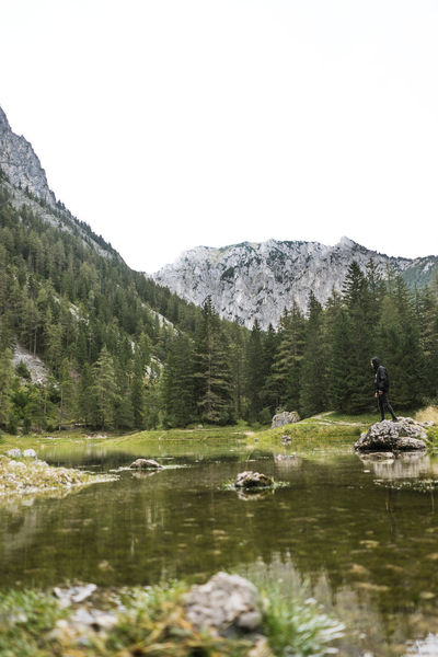 Adventure Beauty In Nature Clear Sky Day Forest Lake Landscape Leisure Activity Men Mountain Mountain Range Nature One Person Outdoors People Real People Rock - Object Scenics Sky Tranquil Scene Tranquility Tree Water Waterfront