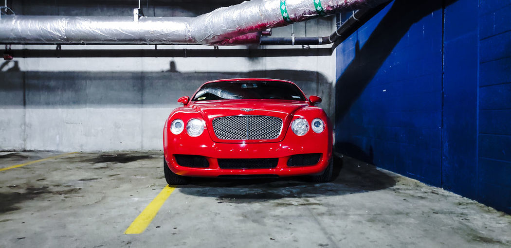 Bentley Transportation Automobile Red Red Color Luxury Luxurylifestyle  Luxury Car Red Car Built Structure Parking Lot Parking Stationary Land Vehicle Vehicle Parking Garage Mode Of Transport