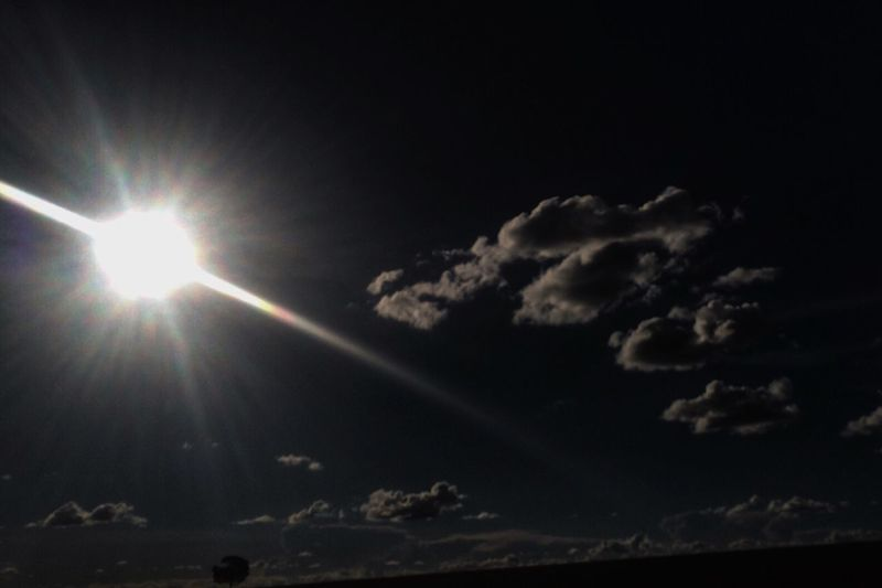Low angle view of sun in sky