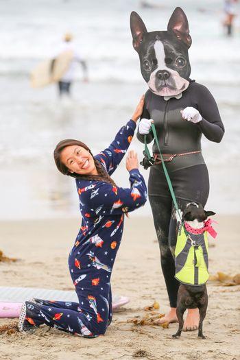 Portrait of happy friends standing on beach