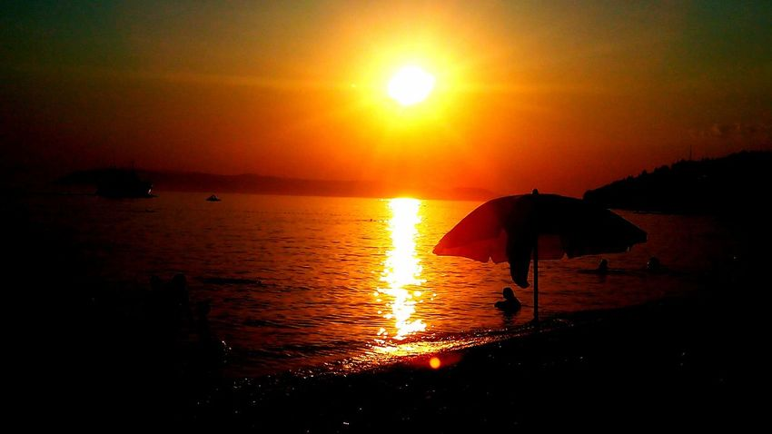 Sunset Sea Sun Reflection Nature Water Scenics Outdoors Tranquility Beauty In Nature Beach People Sky Day