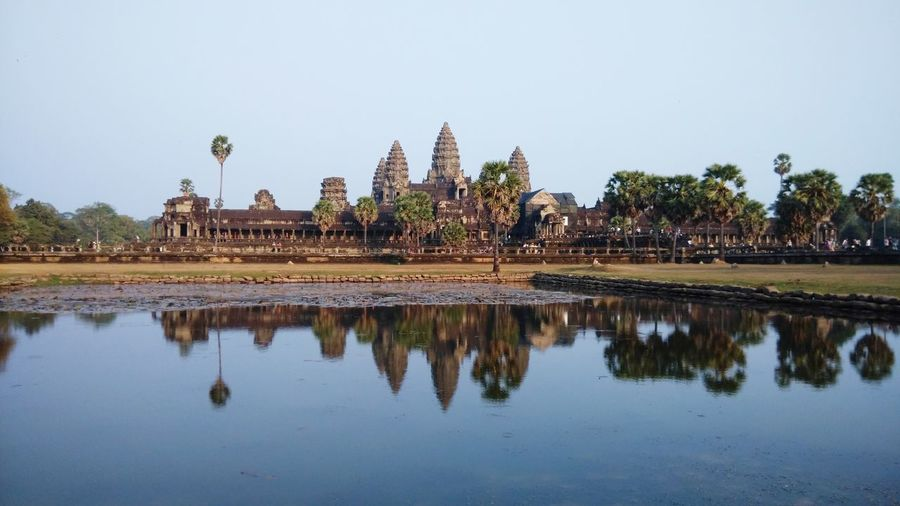 Ang Kor Wat, Cambodia Ancient Civilization Ancient Architecture Temple - Building Architecture Nature Scenery Monument Unesco World Heritage Ancient Civilization Ancient Architecture Ancient Ruins Ancient Building Tree Water King - Royal Person City Lake Palm Tree Religion Reflection Cultures