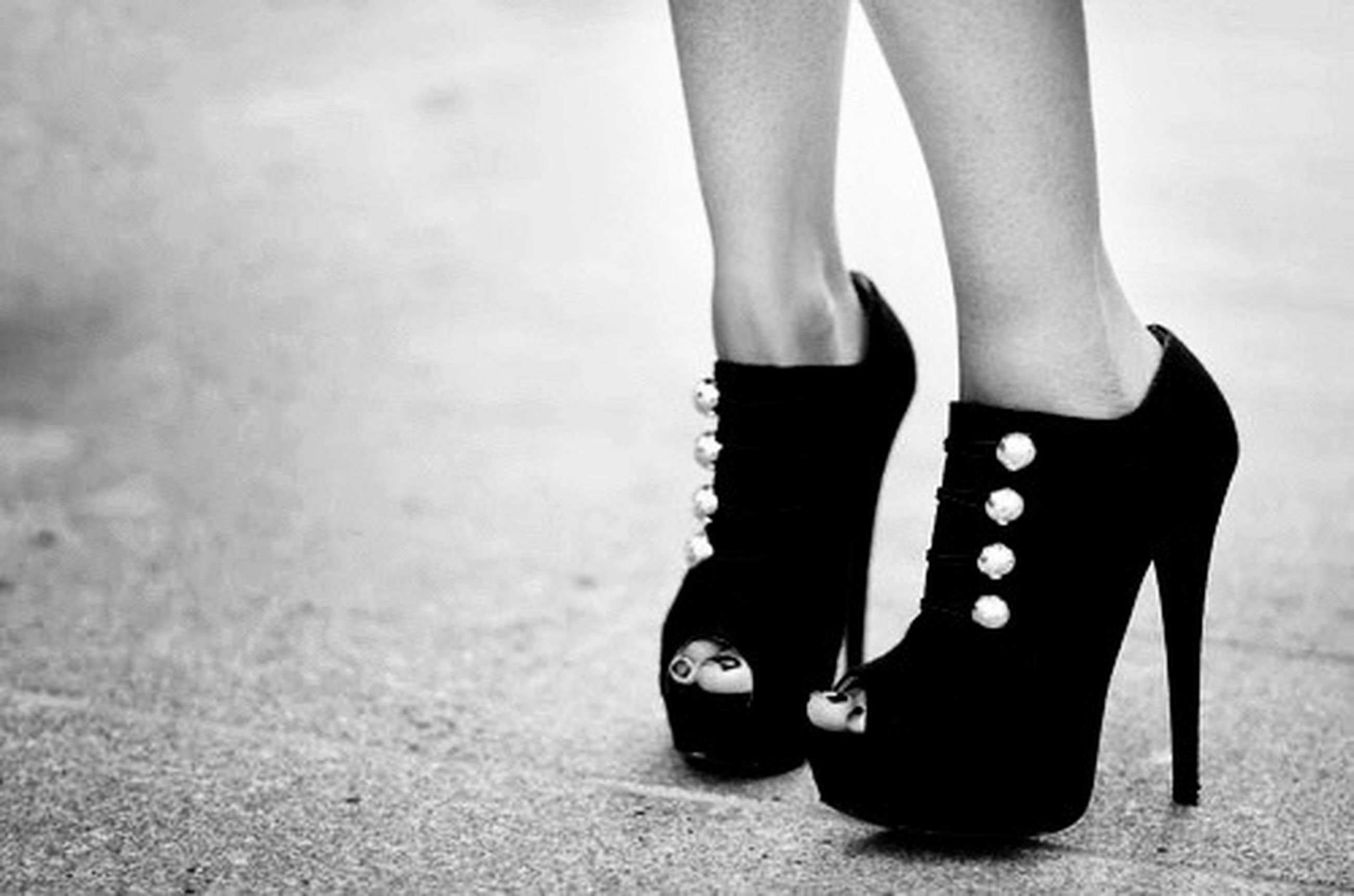 low section, person, shoe, lifestyles, standing, footwear, fashion, human foot, high heels, leisure activity, human limb, sensuality, casual clothing, femininity, jeans, barefoot