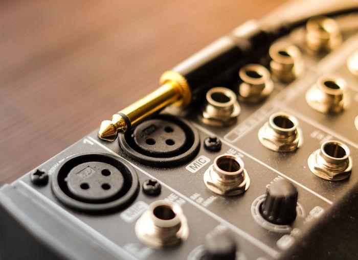 Digital music mixer closeup with a gold jack connector