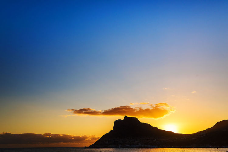 Sunset over Hout Bay Cape Town Holiday Hout Bay South Africa Travel Travel Photography Africa Beach Beachphotography Horizon Over Water Mountain Nature No People Scenery Scenics Sea Sky Sun Sunset Table Mountain National Park Tranquil Scene Tranquility Travel Destinations