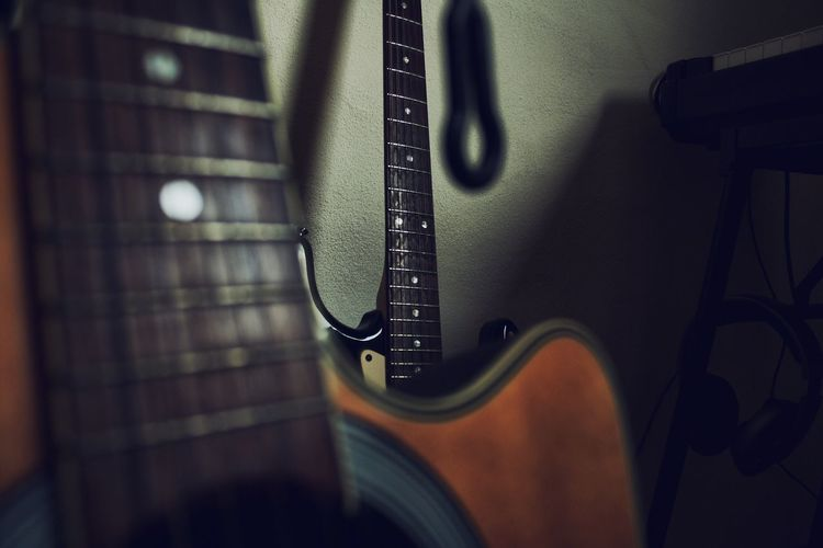 Guitar Musical Instrument Music Indoors  Still Life Musical Instrument String Single Object Arts Culture And Entertainment Close-up String Instrument Acoustic Guitar Musical Equipment Studio Shot Extreme Close-up Electric Guitar Black Background
