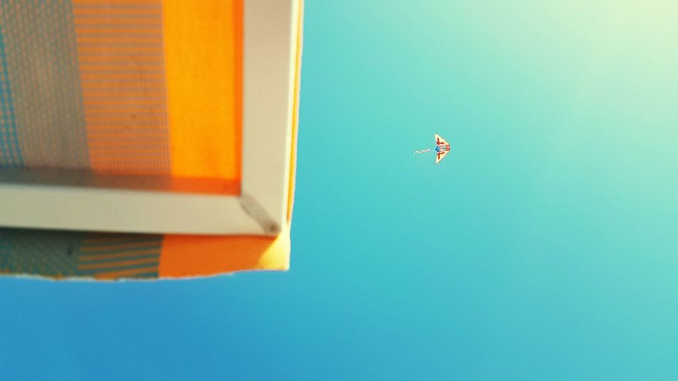 EyeEm Selects Blue Flying Day Mid-air No People Clear Sky Outdoors Balloon Architecture Sky Kite Kite Flying Sand Sommergefühle EyeEmNewHere The Week On EyeEm Paint The Town Yellow Lost In The Landscape Connected By Travel Go Higher Inner Power
