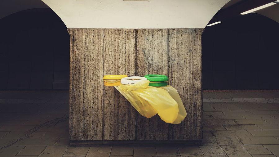 Yellow umbrella on wooden floor