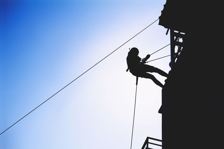 rock rapelling Rope RISK Rock Climbing Danger Hanging Only Men Silhouette Full Length People Low Angle View Safety Extreme Sports Cable Climbing Day Adults Only Adult Strength One Man Only Climbing Rope Go Higher Be Brave 17.62°