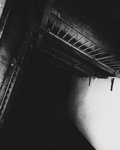 Indoors  Architecture No People Architecture Steps And Staircases Urbanphotography Urban Geometry Architecture_bw Railing Architecture_collection Urban Exploration Built Structure Architecture Photography Looking Down Darkness And Light Black And White Collection  Black & White Art High Up