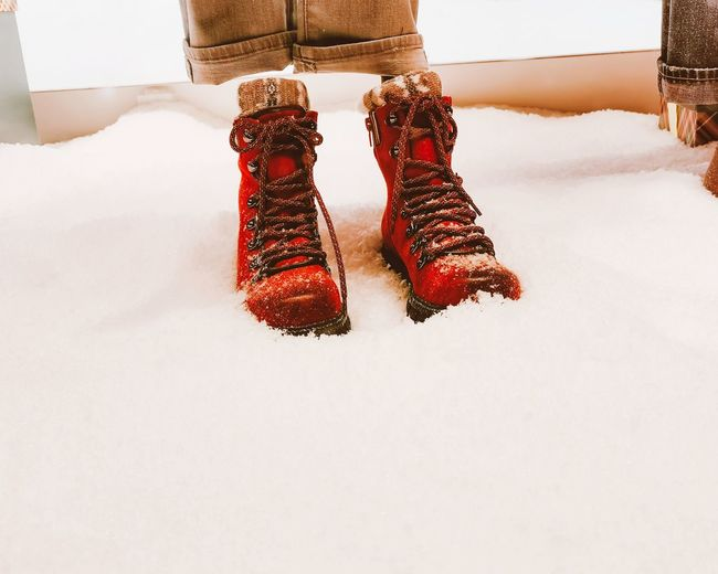 Low section of red shoes in snow