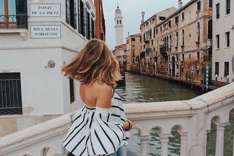 One Person Architecture Water Built Structure Building Exterior Rear View Real People Women Hairstyle Canal Day Hair Lifestyles