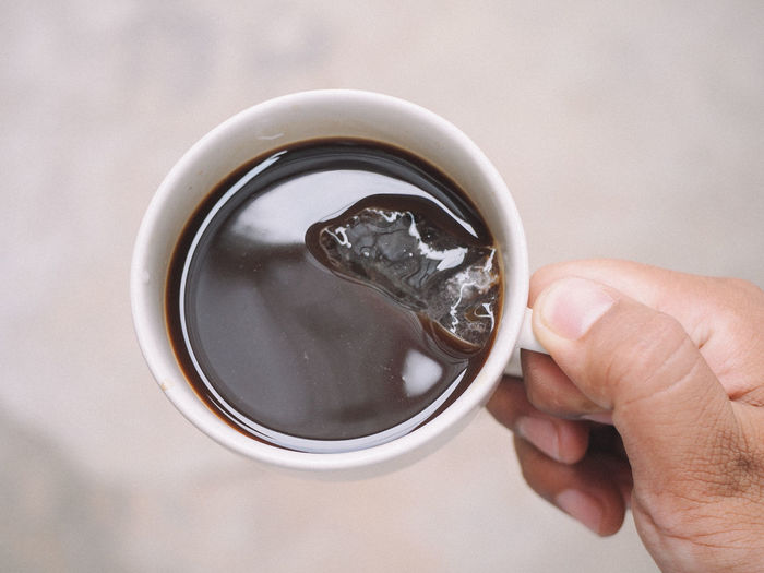 Human Hand Hand Holding Refreshment Food And Drink Human Body Part Drink Cup One Person Real People Mug Coffee Body Part Coffee - Drink Close-up Unrecognizable Person Coffee Cup Finger Focus On Foreground Lifestyles Glass