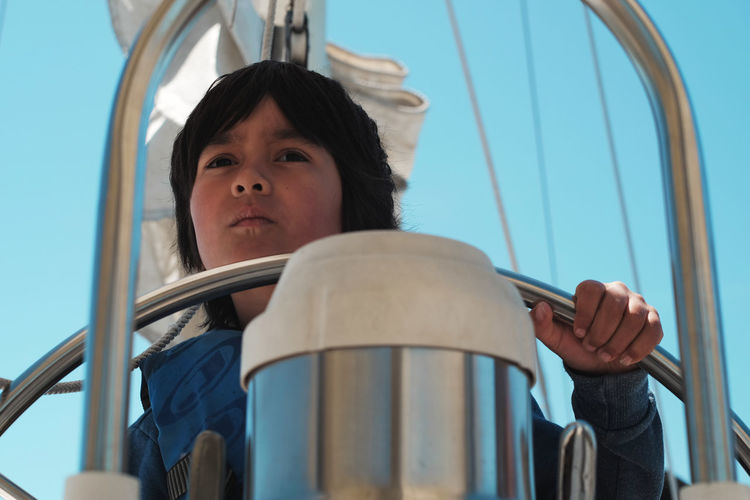 6 year old boy sailing a boat 6 Years Old Bay Berkeley Marina Boat Boy California Childhood Close-up Day Elementary Age Headshot Leisure Activity Lifestyles Low Angle View Marina Ocean One Person Outdoors Real People Sailing San Francisco Sky USA Young Adult