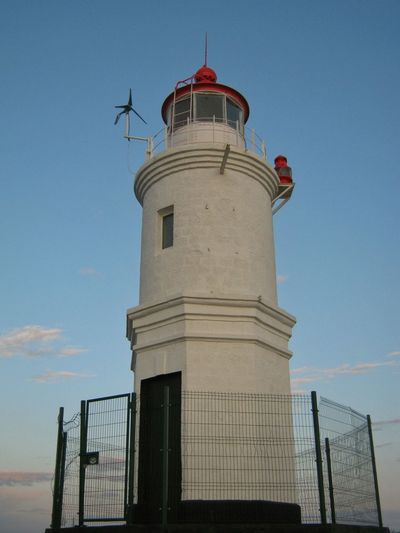 Tokarevskiy lighthouse Lighthouse Architecture Building Exterior Sky Tower Built Structure Travel Destinations Outdoors Day Low Angle View Prison Tokarevskiy токаревский