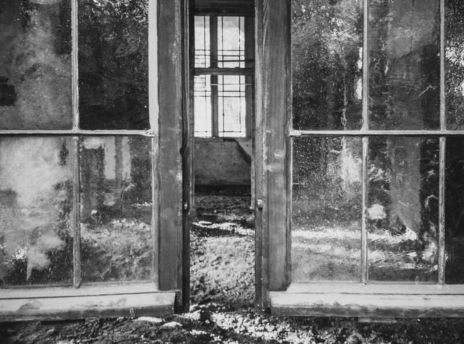 Abandoned Architecture Building Building Exterior Built Structure Damaged Day Deterioration Door Entrance Glass - Material House No People Obsolete Old Outdoors Ruined Run-down Transparent Tree Weathered Window Window Frame