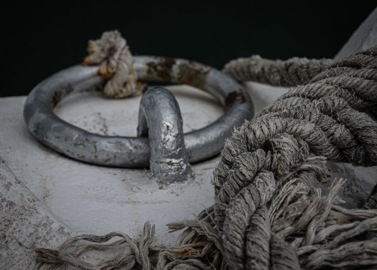 Close-up of rope tied on rusty metal