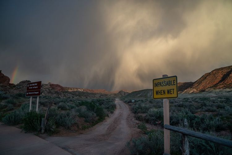 Wetness coming Moab  USA Arches National Park, Utah Sign Communication Text Cloud - Sky Information Road Sky Information Sign Warning Sign Road Sign Beauty In Nature Landscape Scenics - Nature