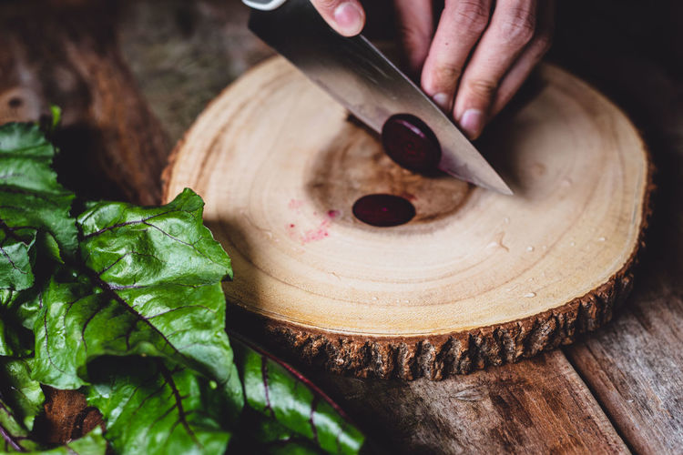 Close-up of person preparing food on cutting board