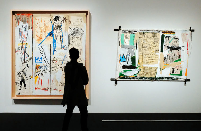 Contemplation Graffiti Jean Michel Basquiat Paintings Rear View Art Arts Culture And Entertainment Exibition Exibition Hall Leisure Activity Lifestyles One Person People Real People