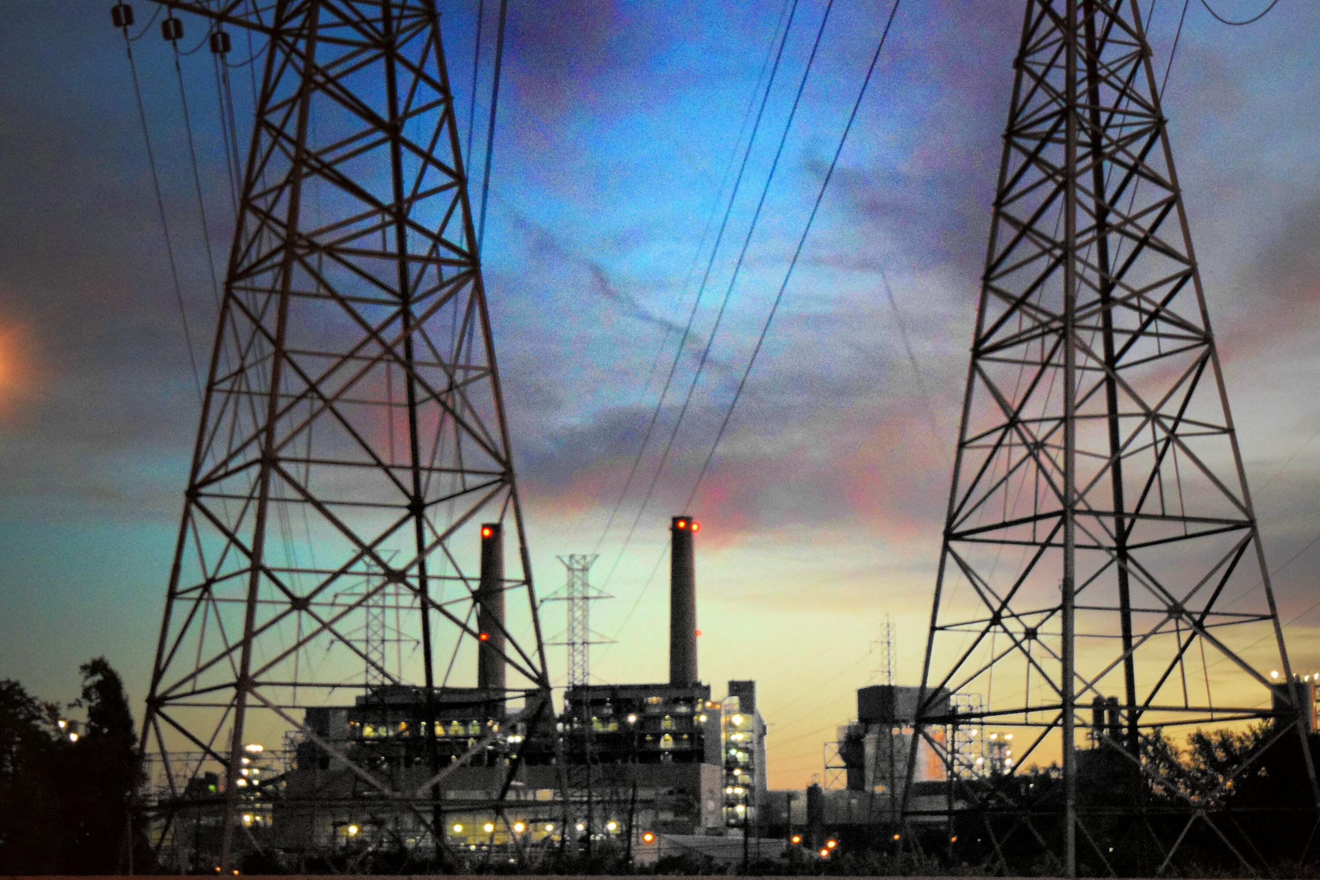 low angle view, built structure, sky, silhouette, architecture, electricity pylon, fuel and power generation, construction site, electricity, development, technology, connection, crane - construction machinery, sunset, cloud - sky, dusk, industry, building exterior, power supply, construction