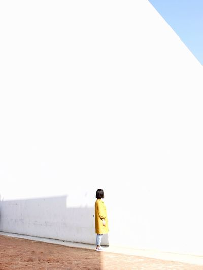 Side view of woman standing on walkway