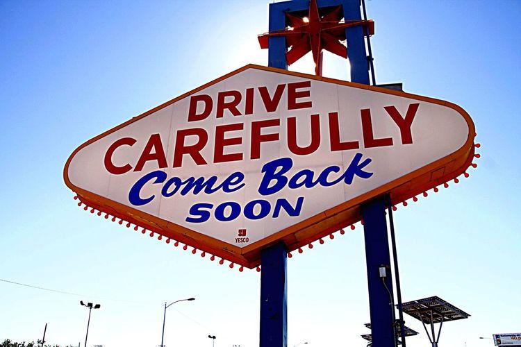 Drive Carefully Sign Against Sky