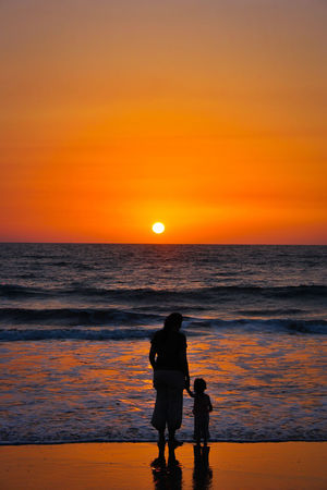Sunset Sunset Silhouettes Sea Feel The Journey Mother & Daughter Love Sunset_captures Sunsetphotographs Clouds And Sky