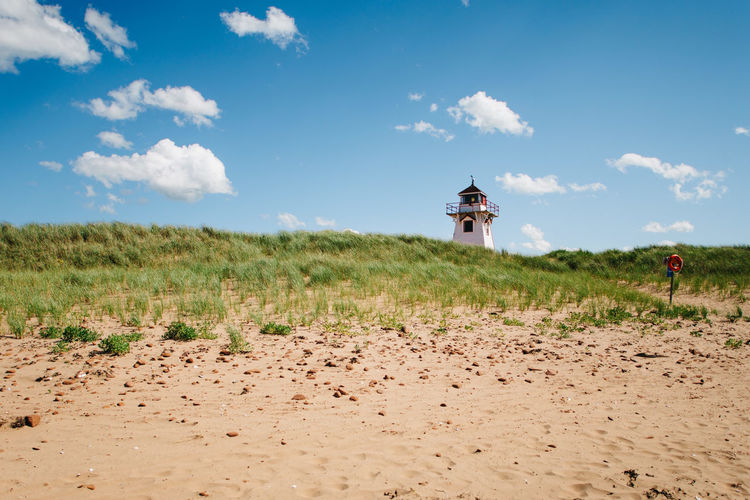 Beauty In Nature Blue Canada Cloud Cloud - Sky Day Field Grass Growth Idyllic Landscape Lighthouse Nature No People Non-urban Scene Outdoors Pei Plant Prince Edward Island Remote Rural Scene Scenics Sky Tranquil Scene Tranquility