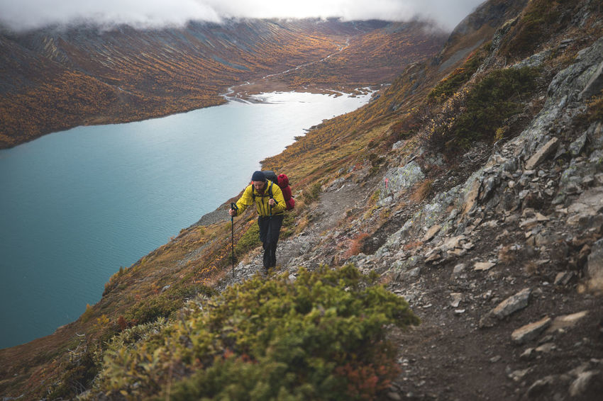On our trek .. day 2 Autumn Brother Colors Jotunheimen Lost In The Landscape Norway Orange Travel Adventure Backpack Clouds Hiking Lake Mountain Nature Orange Tree Outdoors Water