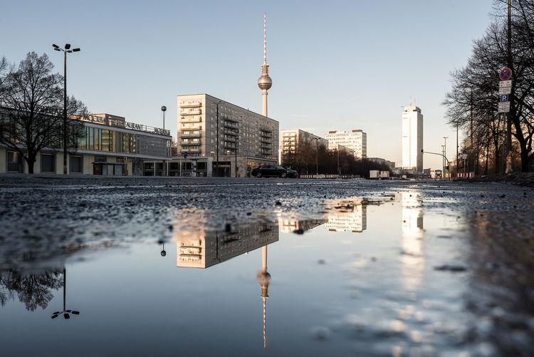 Fernsehturm And Buildings Against Clear Sky