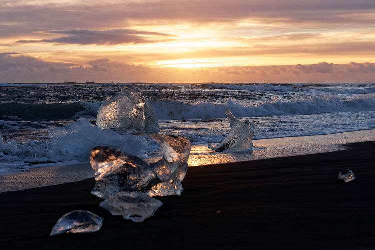 Jökulsárlón Diamond Beach ice reflection with waves at sunrise in winter Iceland Jökulsárlón Diamond Beach Diamond Ice Iceberg Melting Sea Sunrise Sunset Sky Water Scenics - Nature Cold Temperature Cloud - Sky Beauty In Nature Nature No People Travel Destinations Travel Photography Travel First Eyeem Photo Non-urban Scene Vulcanic Landscape Reflection