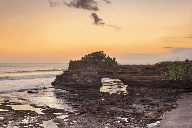 Sunset at Batu Bolong & Tanah Lot - Bali, Indonesia ASIA Bali, Indonesia EyeEmNewHere Lanscape Photography Tanah Lot Temple Vacations Batu Bolong Temple Beach Beauty In Nature Day Horizon Over Water Landcsapes Nature No People Outdoors Rock - Object Scenics Sea Sky Sunset Tranquil Scene Tranquility Travel Destinations Vacation Water