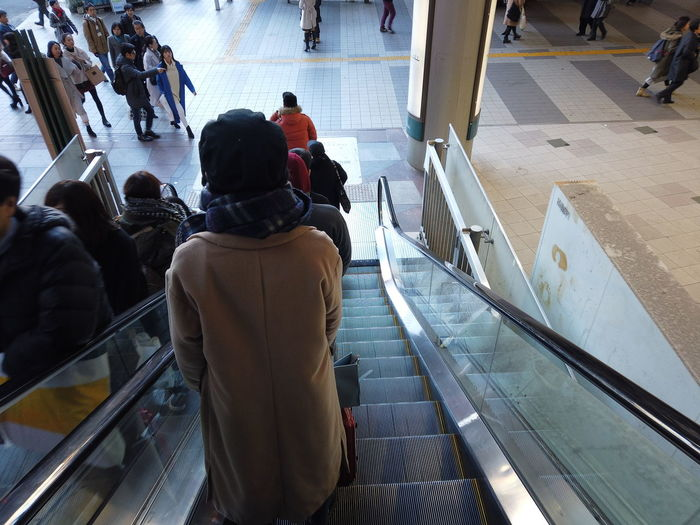 Streetphotography Urban Cityscape City People Urban Life Tokyo Japan Travel Escalator Stairs Real People High Angle View Men Group Of People Crowd Large Group Of People Women Rear View Transportation Lifestyles Indoors  Architecture Adult Railing Leisure Activity Technology Staircase Warm Clothing Moving Walkway