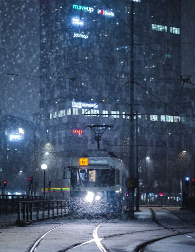 Road in city at night during winter