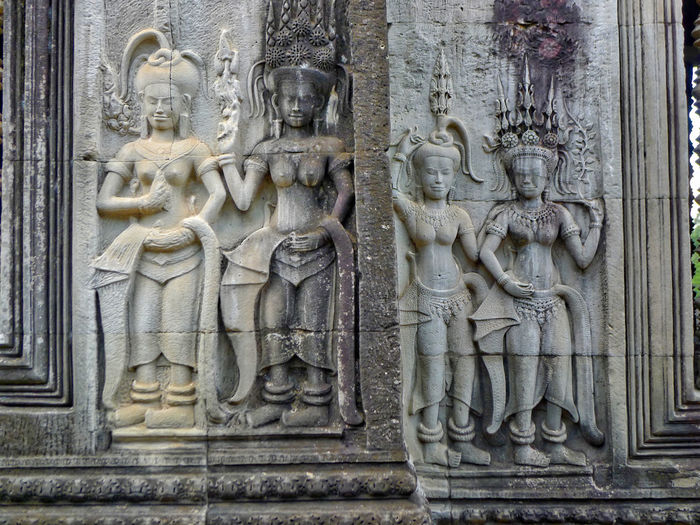 Ancient Angkor Wat Apsaras Architecture Art And Craft Bas Relief Building Exterior Built Structure Carving - Craft Product Close-up Day Human Representation No People Outdoors Sculpture Statue Travel Destinations