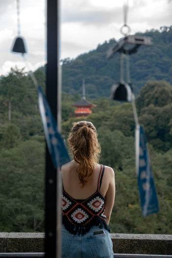 Rear view of woman looking away from camera into the mountains