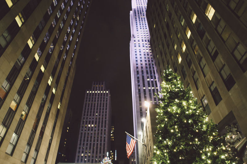 Architecture Building Exterior Built Structure Business Finance And Industry Christmas Christmas Lights Christmas Tree City City City Life Financial District  Illuminated Low Angle View Modern New York Night No People NYC Office Building Exterior Outdoors Rockefeller Center Skyscraper Travel Destinations Tree Winter